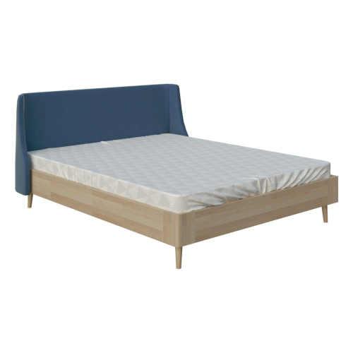 Manželská posteľ v pôsobivej kombinácii dreva a čalúnenia